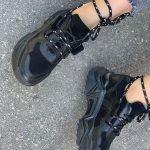 Кожаные крутые кроссовки черного цвета на объемной подошве