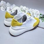 Белые с желтым кроссовки женские