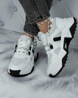 Очень крутые кроссовки белого цвета на объемной подошве