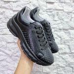 Кожаные кроссовки со сквозной перфорацией черного цвета